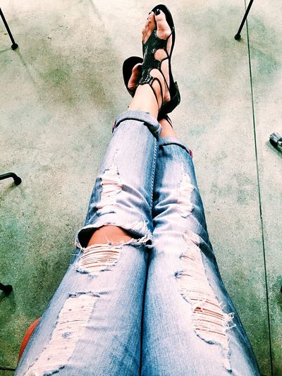 Close-up Day Fashion Human Body Part Human Leg Jeans Jeans Leisure Activity Lifestyles Low Section One Person One Woman Only One Young Woman Only Only Women Outdoors People Personal Perspective Real People Ripped Jeans Shoe Standing