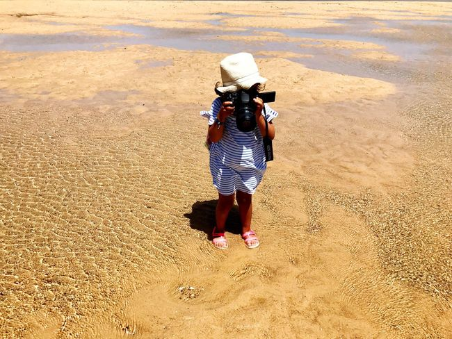 EyeEm Selects Real People Rear View Hat One Person Full Length Sand Photography Themes Photographer Outdoors Photographing Sun Hat Women Camera - Photographic Equipment Asian Style Conical Hat Lifestyles Day Sand Dune Adult Nature Only Women