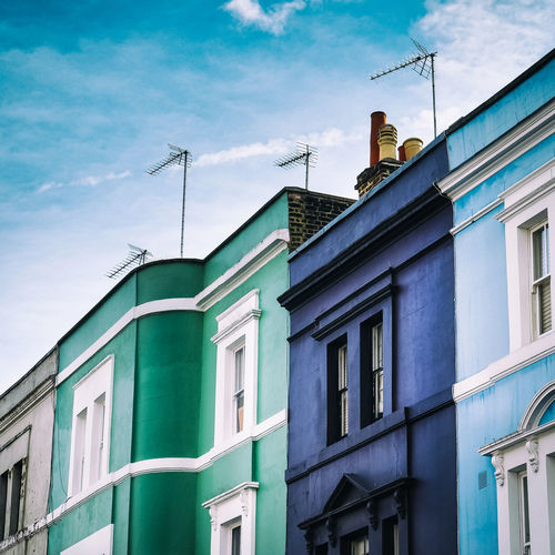 Colorful typical London houses with blue sky in England Building Exterior Architecture Built Structure Sky Cloud - Sky Low Angle View Building Window No People Day Nature Outdoors Residential District City Green Color Glass - Material Communication Multi Colored London Uk Great Britain United Kingdom Traditional Cultures Pastel Colored