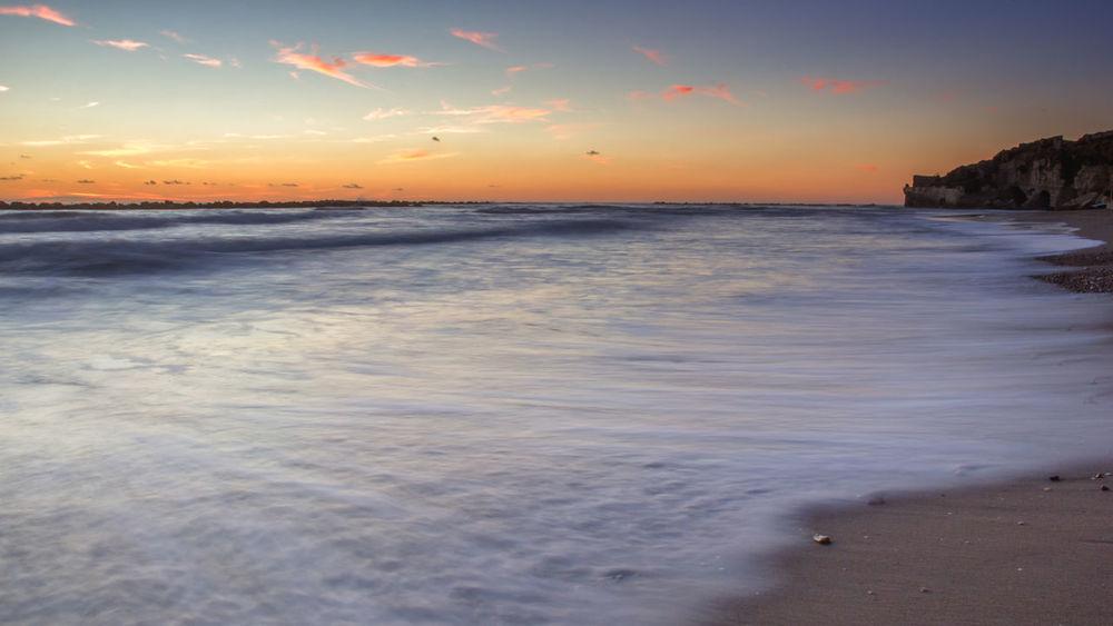 Anzio Anziobeach Beauty In Nature Cloud Cloud - Sky Coastline Dusk Horizon Over Water Idyllic Majestic Nature Non-urban Scene Orange Color Outdoors Remote Scenics Sea Seascape Shore Sky Sunset Tranquil Scene Tranquility Water Wave