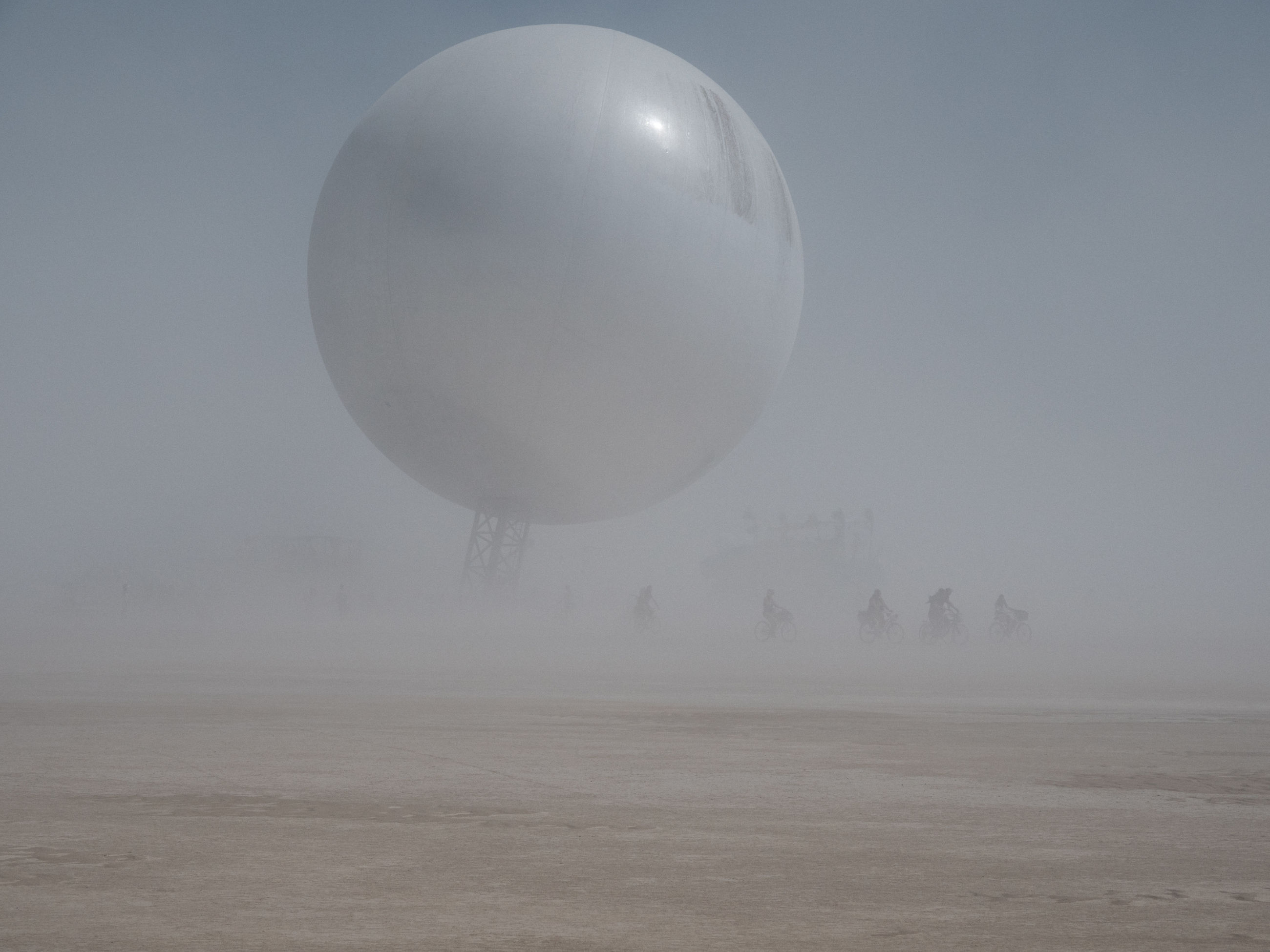 fog, no people, beauty in nature, landscape, scenics - nature, tranquil scene, balloon, nature, environment, sky, tranquility, non-urban scene, tree, cold temperature, day, winter, outdoors, land, field