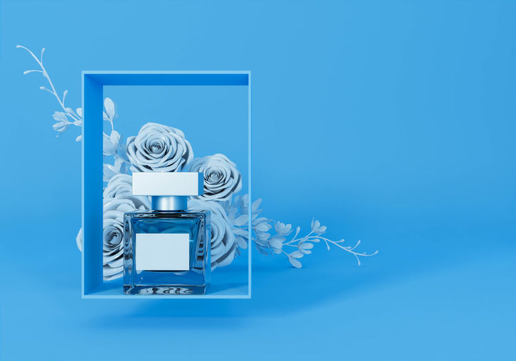 Digital composite of camera against blue background