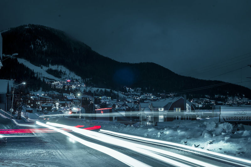 Architecture High Street Illuminated Light Trail Long Exposure Motion Mountain Nature Night No People Outdoors Road Sky Snow Speed Transportation Mobility In Mega Cities