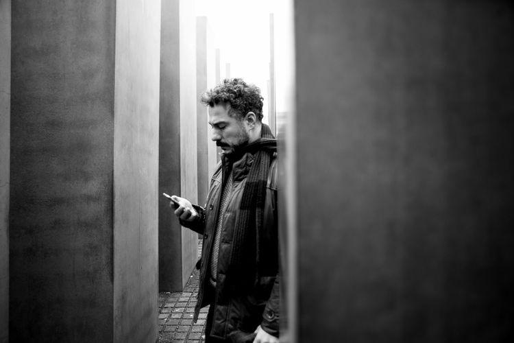 Man using mobile phone on walkway