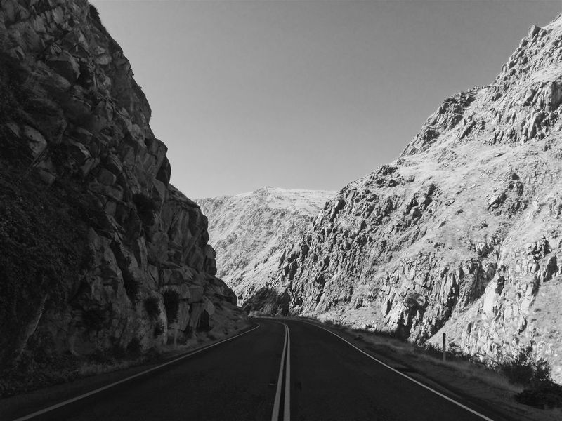 The Way Forward Mountain Road Transportation Nature Clear Sky Day Tranquil Scene Beauty In Nature Scenics No People Mountain Range Landscape Outdoors Tranquility Sky Mountain Road Black And White On The Road Roadtrip