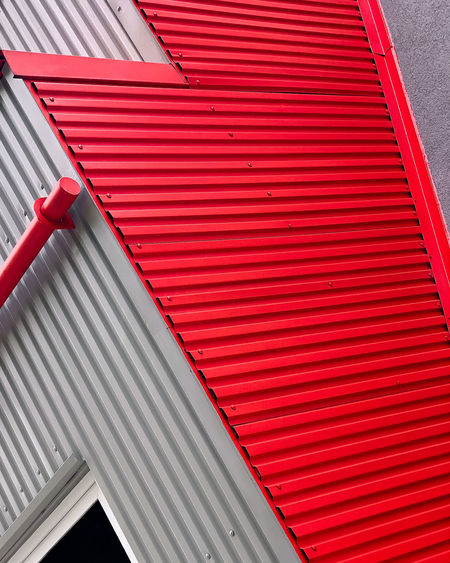 Low angle view of red shutter of building