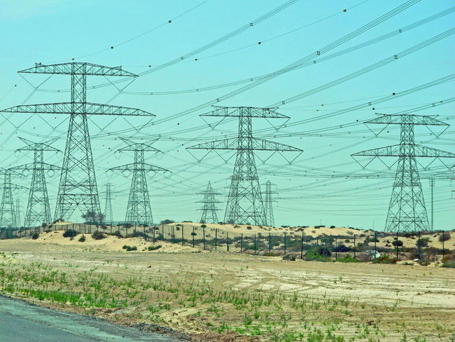 What do you call a large group of electric pylons? - An Army - Dubai, UAE Cable Clear Sky Connection Day Desert Scrub Dubaicity Electric Pylons Electricity  Electricity Pylon Electricity Tower Electricity Wires Fuel And Power Generation Landscape Nature No People Outdoors Power Line  Power Supply Road Sky Technology Telephone Line Transportation UAE , Dubai Lost In The Landscape