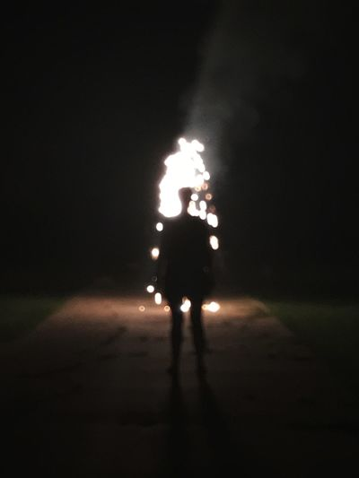 Night Illuminated Real People Glowing Burning Flame Full Length Arts Culture And Entertainment One Person Firework - Man Made Object Dark Men Danger Lifestyles Celebration Sparkler Heat - Temperature Silhouette RISK Firework Display First Eyeem Photo Firework Blurred Motion Sillouette