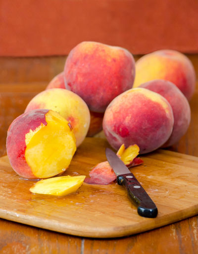 still life of sliced peaches on a cutting board Agriculture Fresh Produce Hello World Knife Nature Orange Summertime USA Vitamins Food Fresh Fruit Healthy Eating Juicy Just Picked Michigan Peaches Natura' Organic Peach Peaches Produce Sliced Fruit Sweet Tasty Yellow