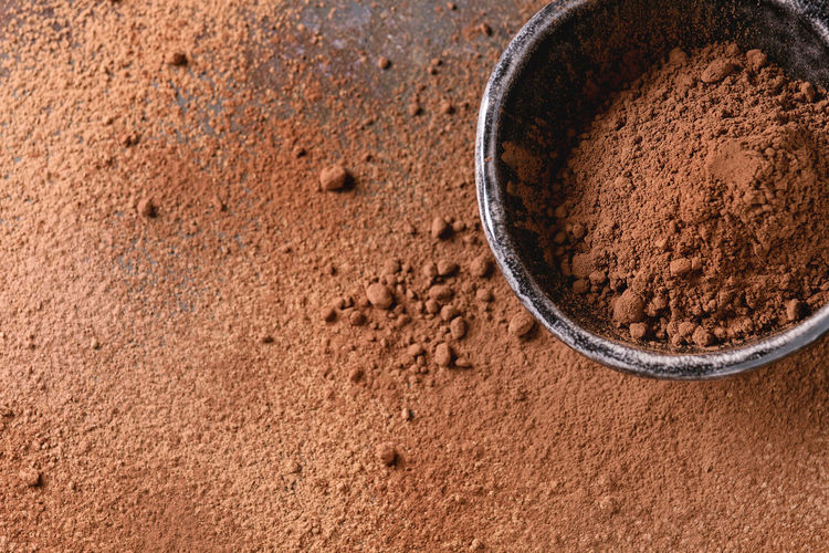 Directly above shot of chocolate powder in bowl