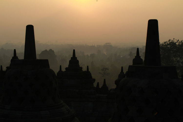 Silhouette of temple building at sunrise