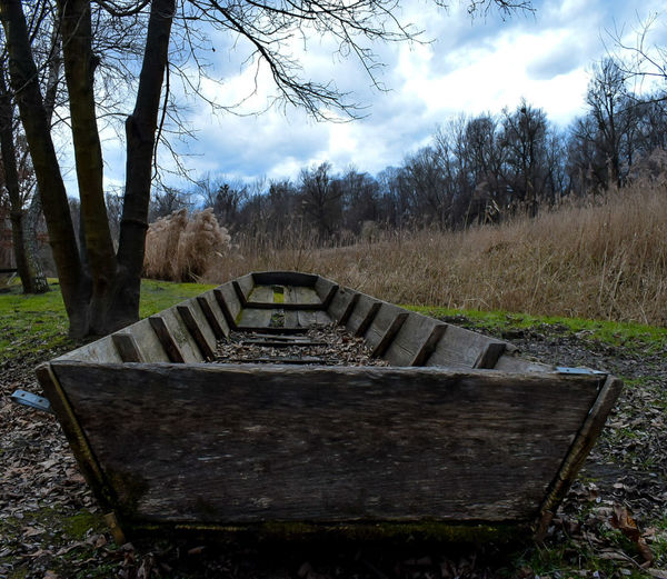 Old boat on the dry land. Boat Wood - Material Nature Landscape Transportation Sky Clouds