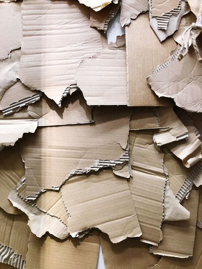 Delivery Online Shopping  Onlineshop Post Package Backgrounds Wood - Material Full Frame Large Group Of Objects No People Wood Still Life Damaged Stack Close-up Table Indoors  Paper Shape Torn Textured  Decline Arrangement Directly Above Pattern