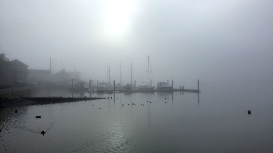 Scenic view of sea against sky during foggy weather