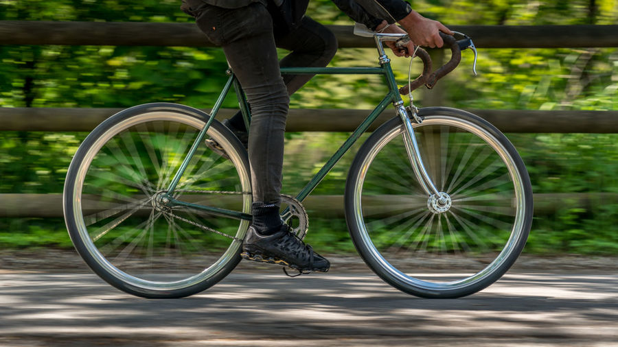 Low section of people riding bicycle