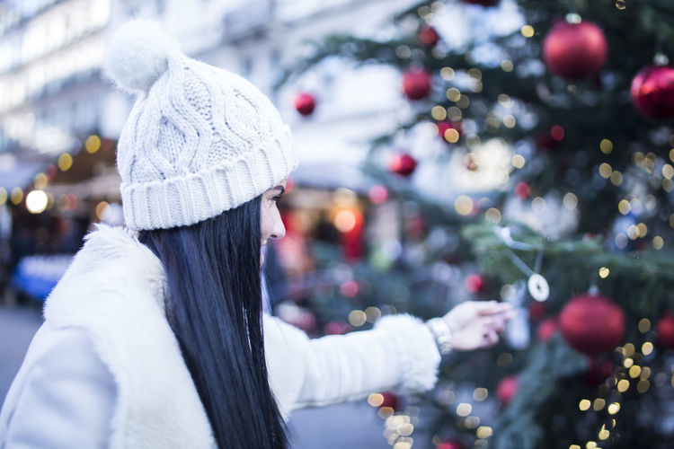 Woman with christmas tree in winter