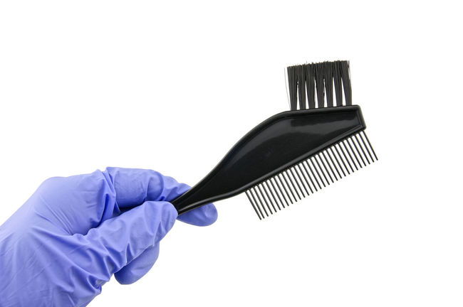 Man wear purple latex glove holding back brush for hair dye isolated with white background. Hair Isolated Background Barber Beauty Black Bleach Bowl Brush Clean Domestic Dye Hairdresser Hand Latex Glove Mix Paintbrush Plastic Protection Purple Rubber Safety Salon Tool White