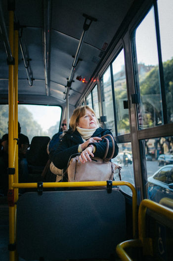 Bus Dreams Vehicle Interior Mode Of Transportation Transportation Land Vehicle Sitting Real People Vehicle Seat Travel Public Transportation Bus Window Lifestyles Glass - Material Seat Women Leisure Activity Car People Portrait Outdoors EyeEm Best Shots EyeEm Selects Human Connection The Art Of Street Photography The Street Photographer - 2019 EyeEm Awards
