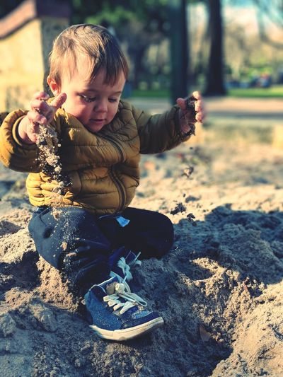 Sand in my shoes and the sun on my back Sand Playtime SweetChildOfMine😘 Perthisok Winterinperth Child Childhood Males  Boys Smiling Portrait Playing Warm Clothing Full Length Happiness Playground Toddler
