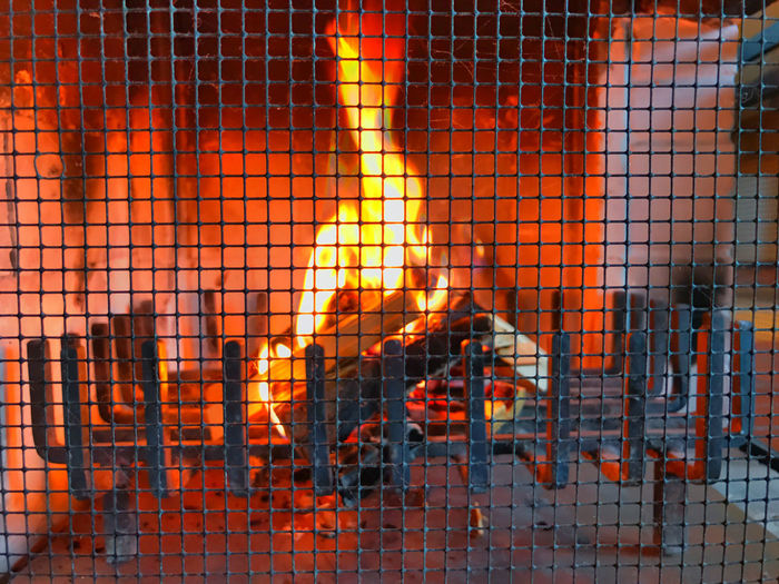 at the fireside Burning Flame Flame Flames Grid Be On Fire Burn Burning Burning Flames Fire Fireplace Fireside Firewood Flame Fuelwood Heat Heat - Temperature Indoors  Warm Warmth