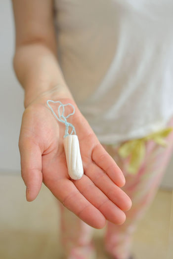 Close-up of woman hand holding tampon
