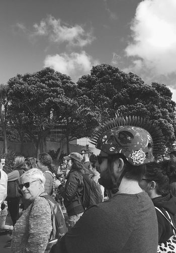 Real People Tree Crowd Large Group Of People Leisure Activity Sky Lifestyles Arts Culture And Entertainment Day Performance Outdoors Adult People Adults Only Bnw_friday_eyeemchallenge Bnw_street Headgear Helmet Ownstyle