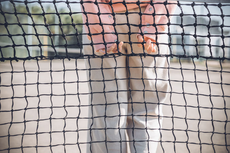 Midsection of woman holding net