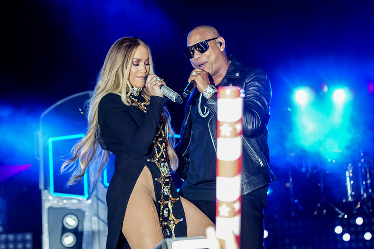 Jennifer Lopez pre-taping a performance with Gente De Zona for the 2017 Macy's Fourth of July Fireworks held in Long Island City, NY. Artist Celebrity Concert Costume Dance Dancing Fun Gente De Zona Jennifer Lopez Jlo Light Microphone Music Musicians Night Singer  Singing Stage Train Two People
