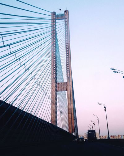 TakeoverContrast Bridge - Man Made Structure Connection Architecture Built Structure Engineering Clear Sky Transportation Low Angle View Blue Cable Cable-stayed Bridge Steel Cable Sky The Way Forward Outdoors Flying Skyscraper Modern No People