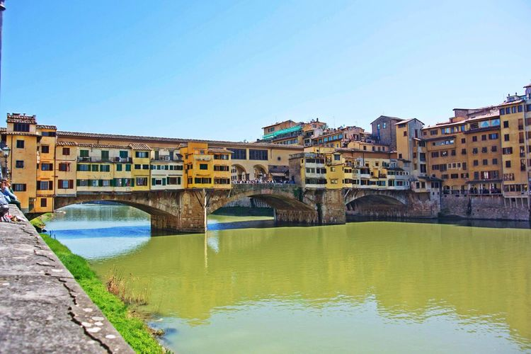 Ponte Vecchio Over Arno River Against Clear Sky