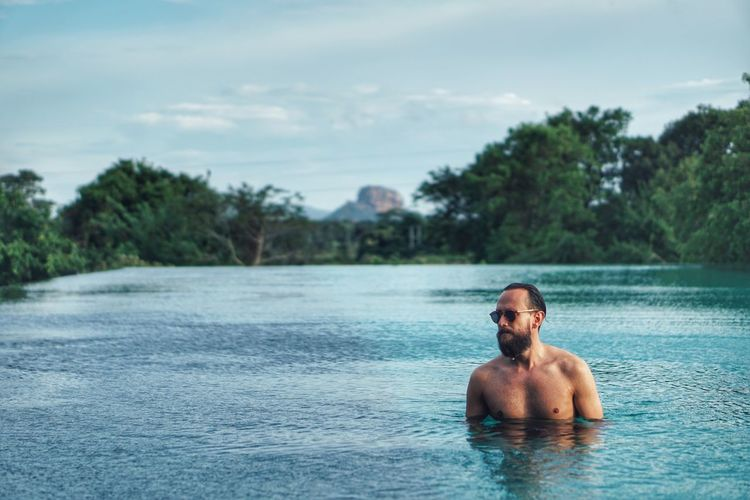 Shirtless Water Real People Sky One Person Day Leisure Activity Outdoors Waterfront Tree Nature Lifestyles Headshot Swimming Pool Young Adult Looking At Camera Portrait Beauty In Nature One Man Only Only Men Lost In The Landscape Second Acts An Eye For Travel
