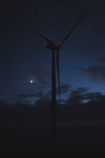 Sky Low Angle View Fuel And Power Generation Night Cloud - Sky Renewable Energy No People Alternative Energy Nature Turbine Environment Wind Turbine Silhouette Wind Power Environmental Conservation Technology Beauty In Nature Scenics - Nature Moon Dusk Outdoors Dark Sustainable Resources Power In Nature