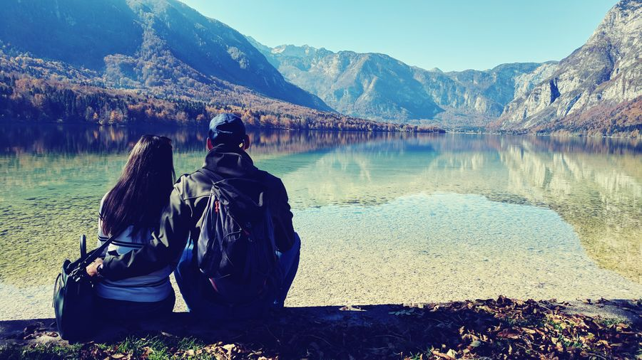 Mountain Snow Winter Rear View Lake Adult Outdoors Cold Temperature People Vacations Day Mountain Range Adventure Landscape Sitting Adults Only Only Men Nature Sky Mammal Autumn Bohinj Slovenia Young Adult Real People