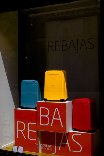 A Samsonite bright yellow suite case on sale (rebajas) in the fashion district of Serrano in Madrid, Spain. Shopping Travel Traveling Architecture City Commercial Sign Communication Editorial  Information Information Sign Luggage No People Sign Suite Case Suitecases Text Western Script Yellow