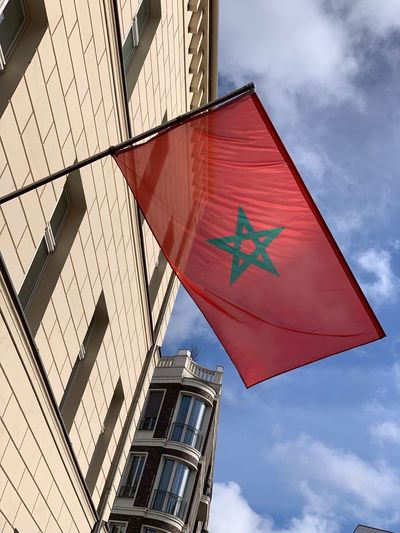 Morocco 🇲🇦 Morocco Low Angle View Sky Architecture Built Structure Building Exterior No People Day Nature Building Red Cloud - Sky Outdoors Flag Sign City Symbol Road Sign Road Sunlight Shape