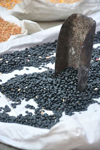 Close-Up Of Black Lentils At Market Stall For Sale