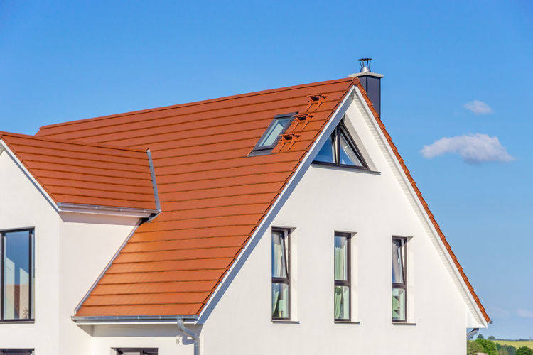 red tiled roof - blue sky Low Angle View Day No People Roof Nature Window Built Structure Building Building Exterior Architecture Triangle Shape Roof Tile Sunlight High Section Residential District Outdoors Sky Blue Clear Sky House White Color Row House