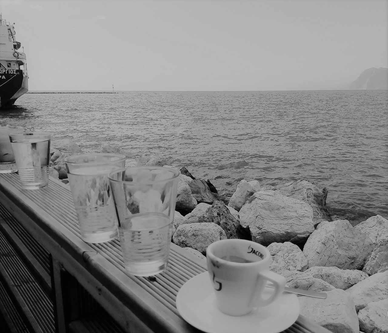 coffee cup, sea, water, drink, horizon over water, table, saucer, coffee - drink, food and drink, refreshment, no people, clear sky, outdoors, nature, day, sky, close-up