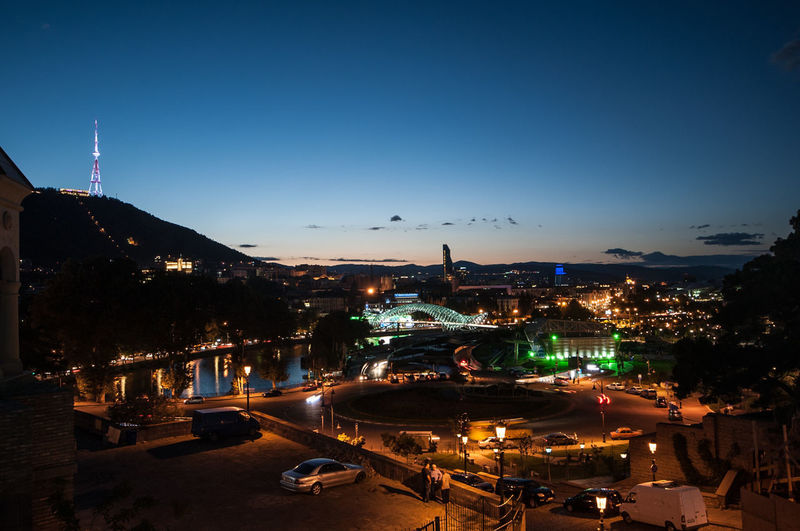 Tbilisi by night Sky Illuminated Architecture Built Structure Night Water Building Exterior City Transportation Nature High Angle View No People Mode Of Transportation Outdoors Building Travel Destinations Dusk River Cityscape