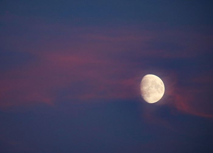 Moonlit sunset Sunset Sky Night Astronomy Space Moon Scenics - Nature Tranquil Scene Beauty In Nature Tranquility Planetary Moon Nature Cloud - Sky No People Idyllic Low Angle View Outdoors Majestic Exploration Copy Space