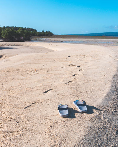 Some of the best memories are made in flip flops. Absence Beach Beauty In Nature Blue Day Flip-flop Nature No People Outdoors Pair Sand Sea Shoe Shore Sky Slipper  Sunlight Things That Go Together Tranquility Vacations Water EyeEmNewHere Modern Workplace Culture Go Higher The Still Life Photographer - 2018 EyeEm Awards