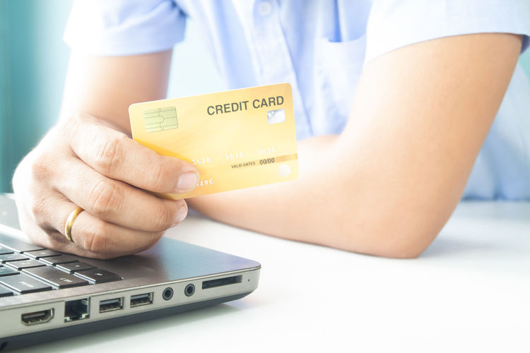 Man hand holding plastic credit card. E-payment, business and money concept Hotel Trip Passport Cart Traveler Plastic Cards Concept Entering E-commerce Cvv Ordering Wireless Tax Male Order Debit Smart Security Man Typing RISK Information Data Lifestyle Phone Ecommerce Keyboard Notebook Finance Electronic Internet Store Home Buy Technology Commerce Banking Using Purchase Business Pay Computer Shopping Laptop Holding Payment Online  Card Credit