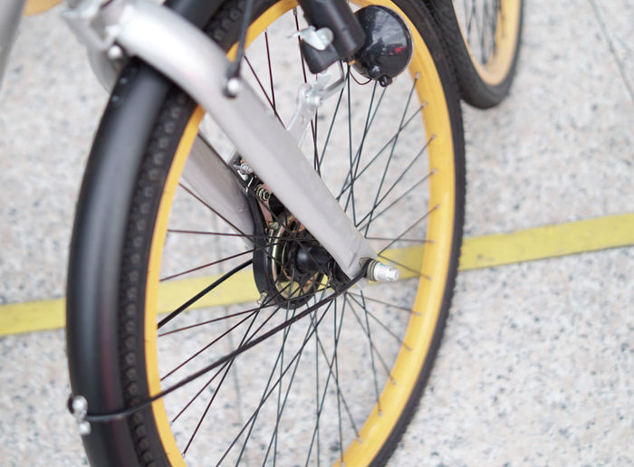 High angle view of bicycle wheel on road