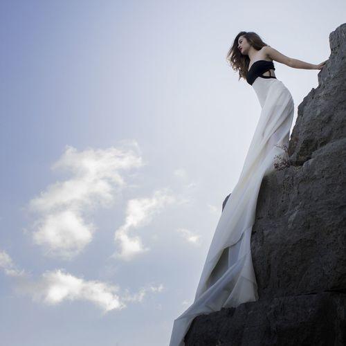 A second before jumping. Jump Visual Creativity Bride Wedding Dress Young Women Beauty Bridegroom Women Well-dressed Beautiful Woman Females Wedding Veil