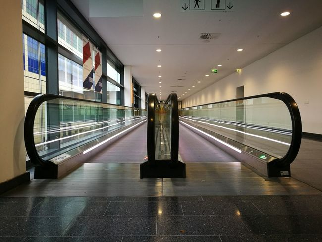The Way Forward Rollsteig Fahrsteig Laufband Taxiway Transport Transportation City Indoors  Architecture Illuminated Travel Destinations No People Politics And Government Indoors  The Way Forward