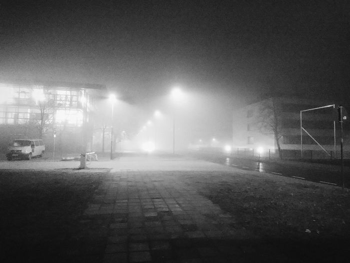 After Work On The Street Way To Go Home Foggy Day Cannot See Front Dark Night Streetlamps Lights From Buildings Smartphonephotography Cottbus Germany Alone In The Dark Traveling Home For The Holidays Btu Cottbus German Weather The City Light