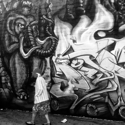 ... And our heroine escapes unscathed - perhaps unwittingly ;) Street Art Street Photography Black And White People