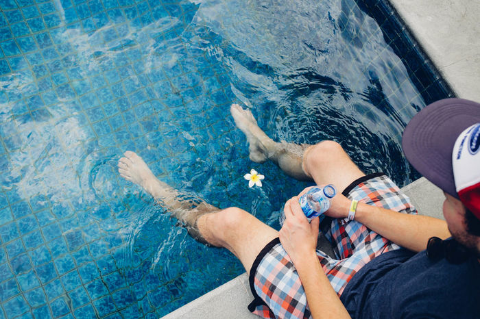 Ambon ASIA Blossom Blue Cap Feet Flower INDONESIA Legs Leisure Activity Lifestyles Maluku  Men Person Personal Perspective Pool Swimming Pool Traveling Wanderlust Waves