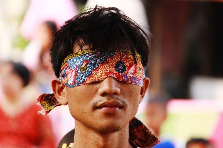 Close-up portrait of a man with a batik
