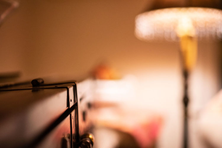 Selective Focus Close-up Indoors  Focus On Foreground Human Body Part Motion Lighting Equipment One Person Music Musical Instrument Domestic Room Arts Culture And Entertainment Craft Technology Man Made Kitchen Illuminated Human Hand Electric Lamp Entertainment Event Stage